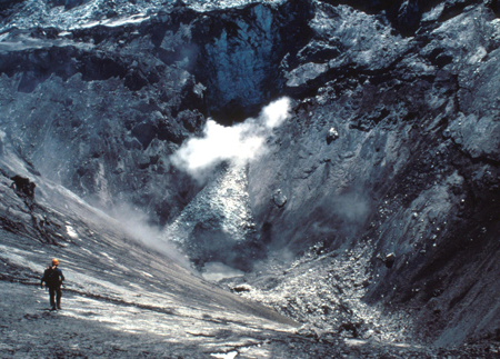 David Johnston climbing into a summit crater to collect samples