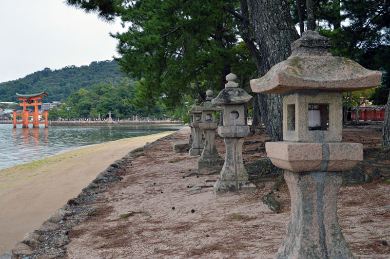 Coastal walkway with Japanese torii gate