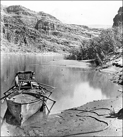 Black-and-white photo of a rowboat in the Grand Canyon