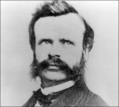 Black-and-white photo of a mustachioed man