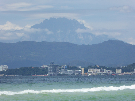 Mount Kinabalu towers over Kota Kinabalu, the capital of the Malaysian state of Sabah in northern Borneo.