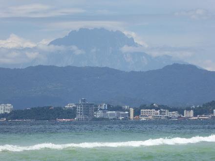 Mount Kinabalu towers over Kota Kinabalu, the capital of the Malaysian state of Sabah in northern Borneo.