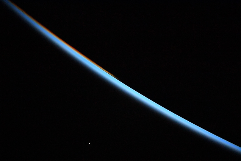 International Space Station photo of Earth's horizon and Venus