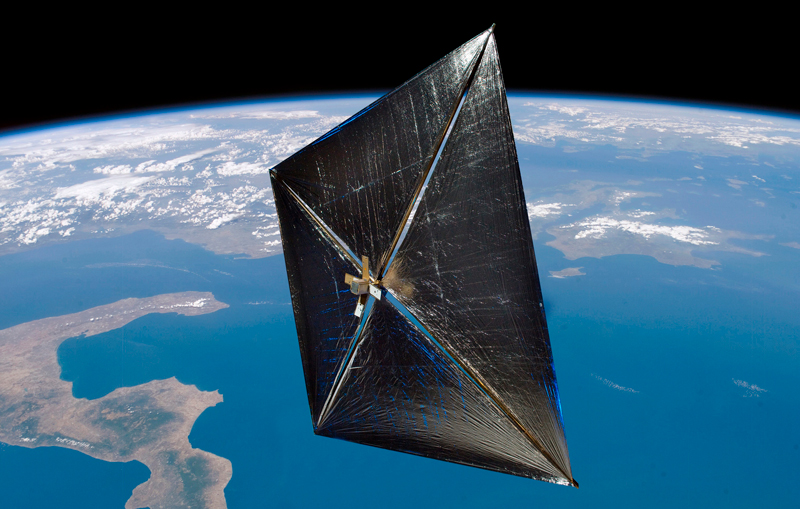 Illustration of a solar sail satellite in orbit above the Earth