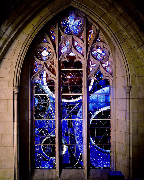 Space-themed stained glass window