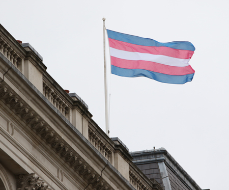 Transgender flag flies at office building