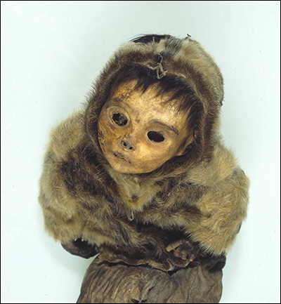 Photo of a mummified infant in a thick fur parka