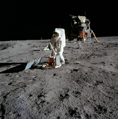 Astronaut placing instrument on the Moon