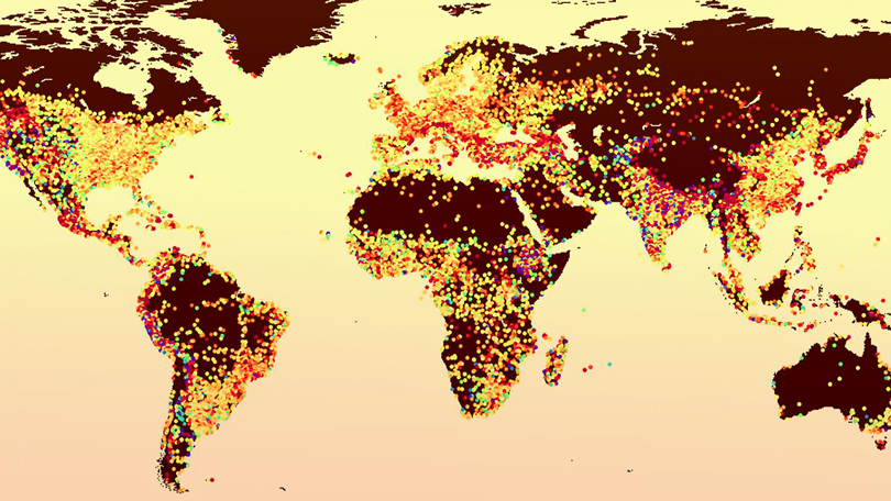 Map of the world with colored dots over cities