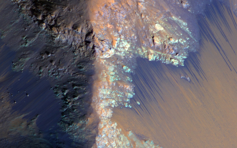 Dark streaks along slope of a crater on Mars