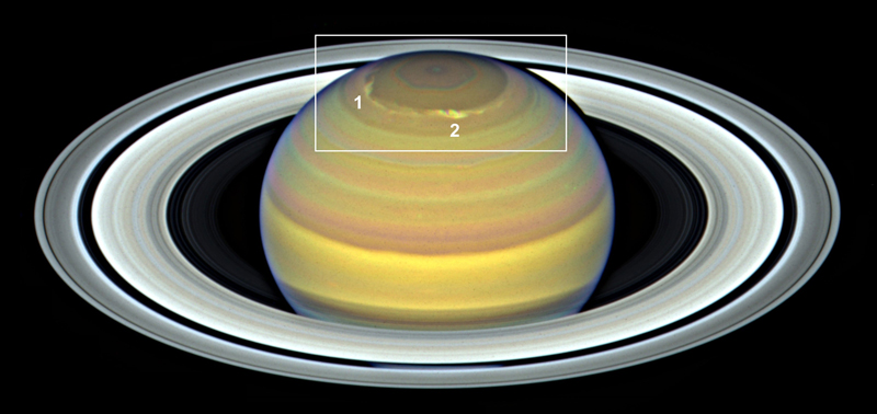 Image of Saturn with its north pole squared off and two storms identified
