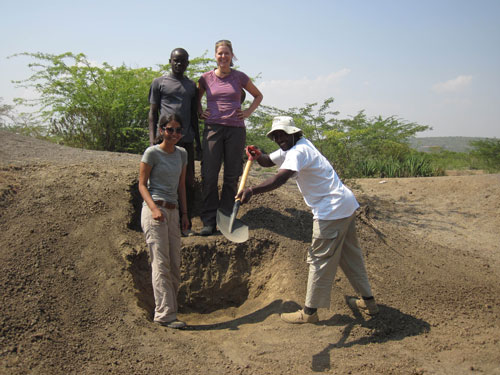 Four people near a rocky outcrop in Kenya