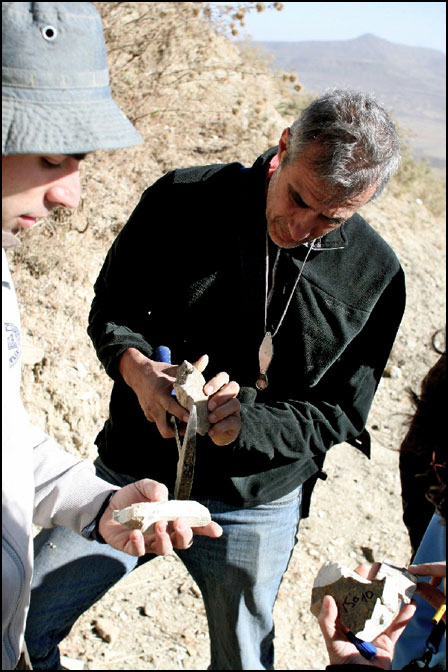 : The study's lead author, Claudio Faccenna, examines a rock as part of the geological field evidence portion of the project.
