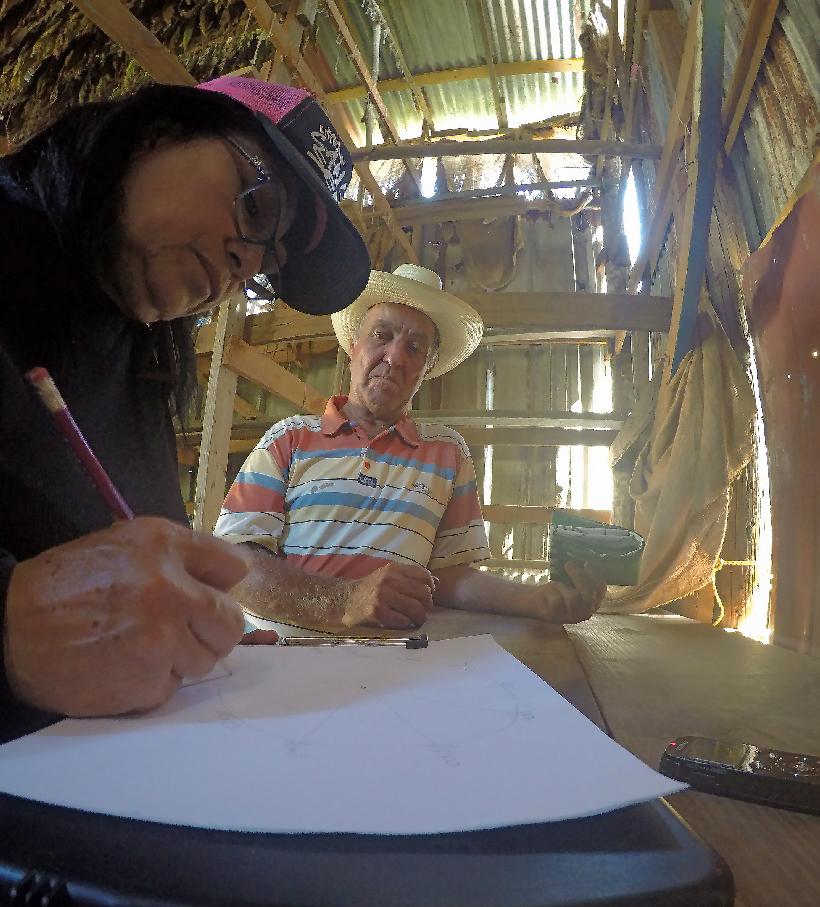 Norma Ortiz interviews an elder in Cidra