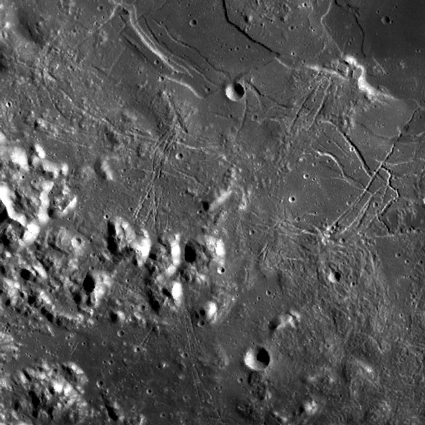 Image of the lunar surface, showing trails left by tumbling boulders