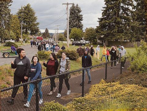 High school students walk along an evacuation route
