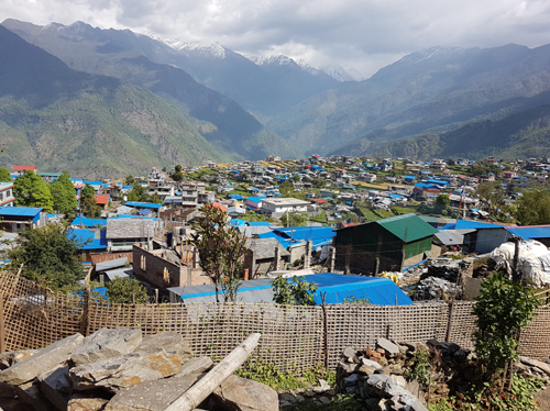 Himalayan valley village with many blue roofs