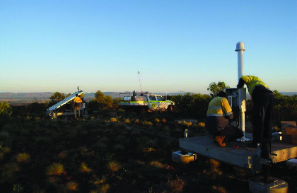 Engineers install a lightning sensor in rural Australia