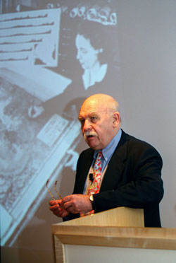 Walter Pitman addresses a Lamont-Doherty awards ceremony, with a photo of marine cartographer Marie Tharp in the background.