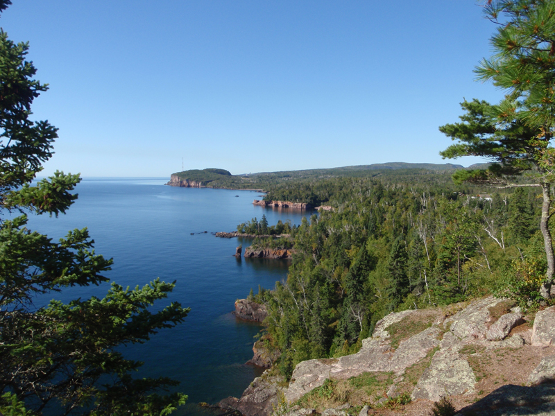Dark volcanic cliffs rim the shore of Lake Superior.