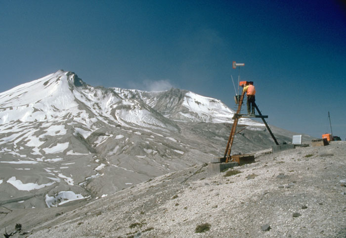 A scientist surveys the bulging flank on Mount St. Helens after the 1980 eruption.