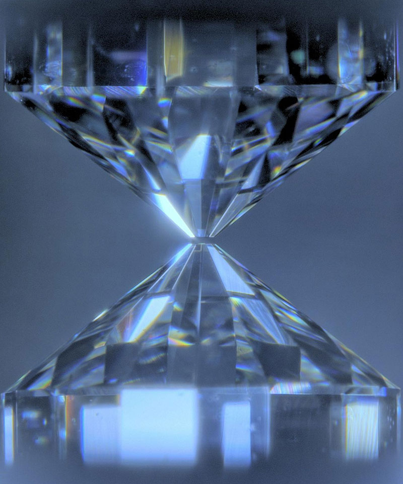 Close-up of two diamonds with their points facing each other