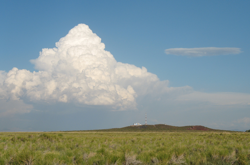 A thunderstorm looms on the horizon near the hillside site of one of the Pierre Auger Observatory's fluorescence detectors