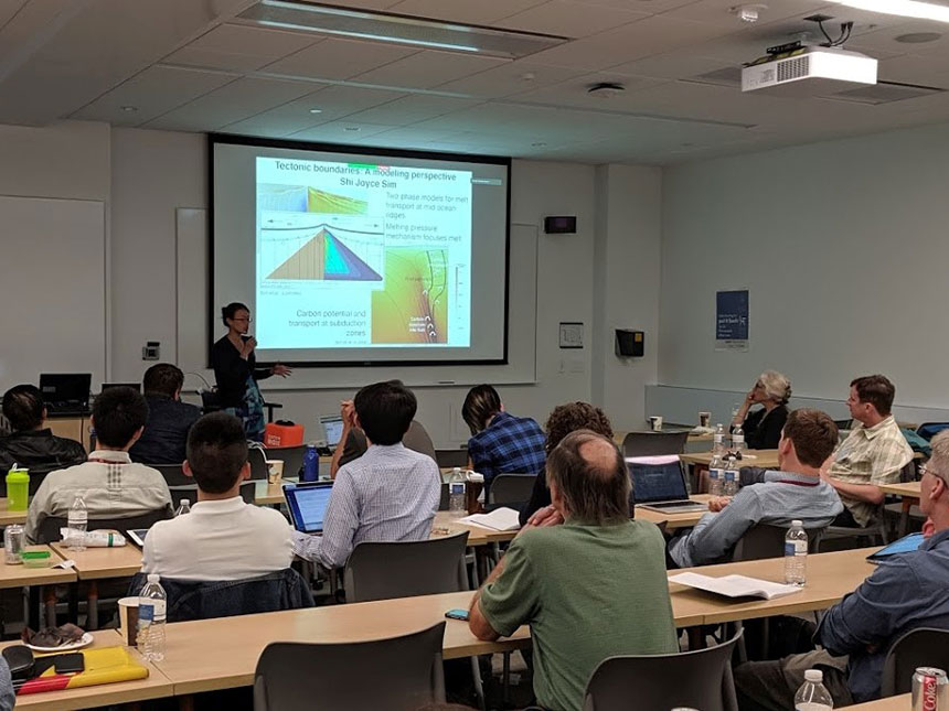 Scientists listen to a keynote presentation during a workshop in 2019