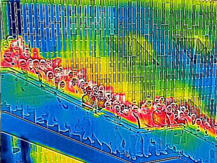 A thermal infrared photo of several dozen people standing on a staircase