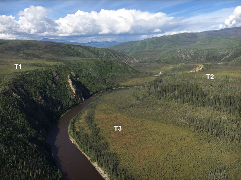 Aerial view of a bend in the Fortymile River and the surrounding landscape in Alaska