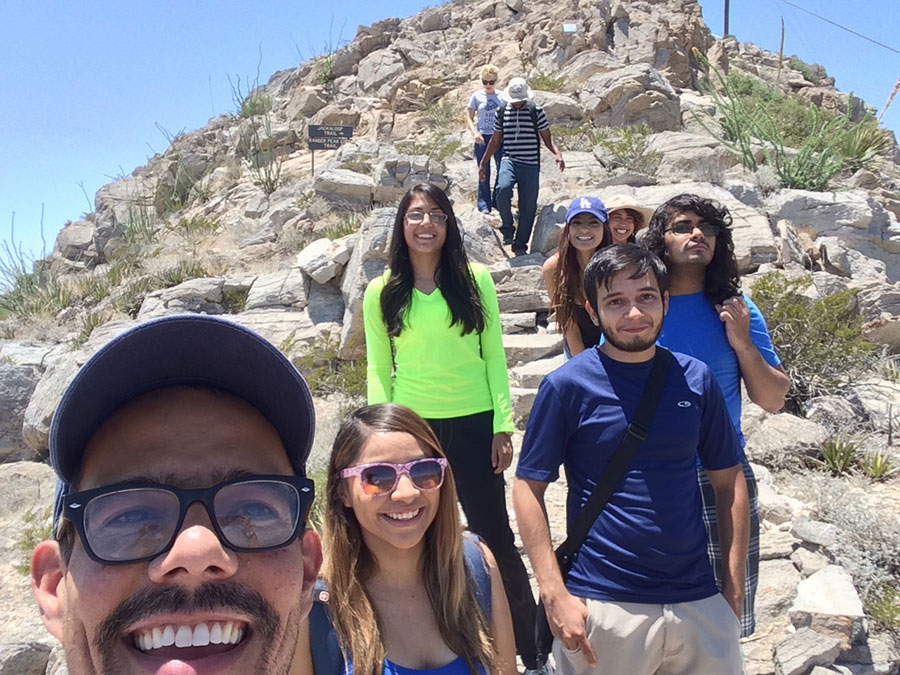 Students and their professor pose among paleo-karsts in the field.
