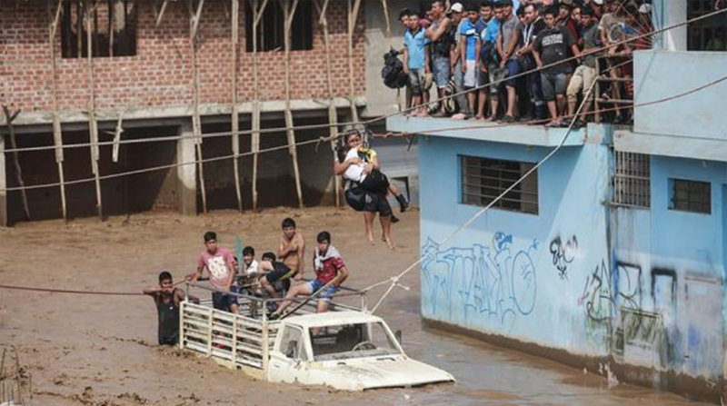 Photo showing flooded streets and people being rescued in Peru during the 1997–1998 extreme El Niño