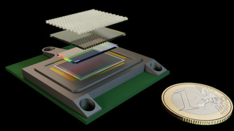 A 3D render of the LOUPE mission instrument (plus a 1 euro coin for scale)