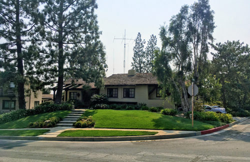 An antenna setup towers over a residential house in Los Angeles, Calif.