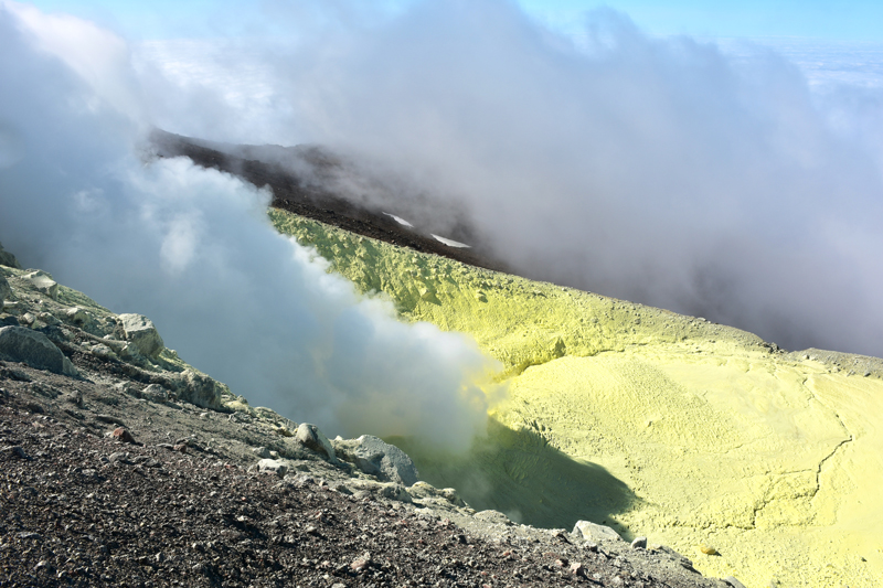 Yellow sulfur deposits surround, and plume of gas rise from, fumaroles on the flank of Kiska volcano in the western Aleutian Islands