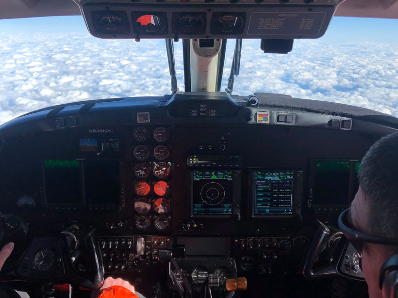 View of shallow cumulus clouds from the cockpit of the King Air