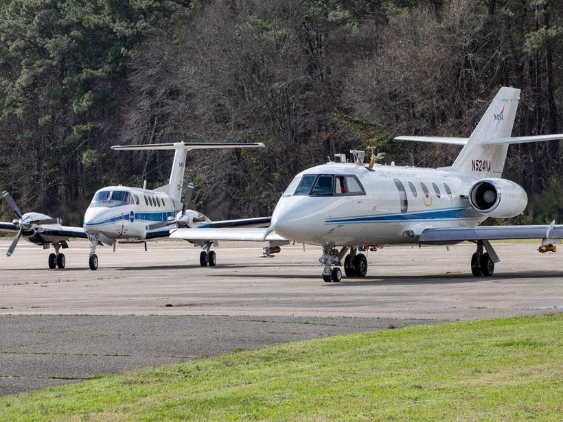NASA's King Air and Falcon sit on the tarmac at NASA Langley Research Center