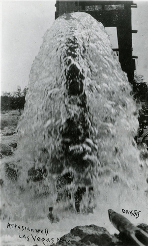 Black-and-white photo of a flowing artesian well