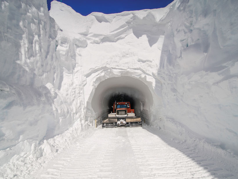 A red truck emerges from a giant tunnel in the ice at Dome Concordia in Antarctica