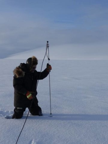 Matthew Sturm probes for snow depth.