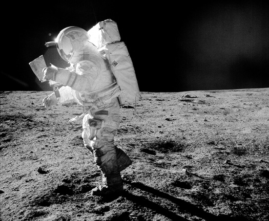 Black-and-white photo of astronaut Edgar Mitchell walking on the Moon