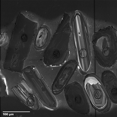 Magnified view showing the internal structure of zircon crystals