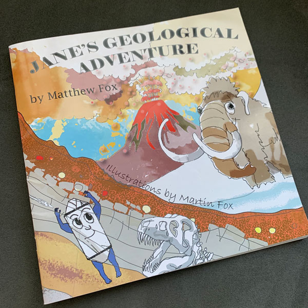 Photo of the front cover of Jane's Geological Adventure, set against a gray background.