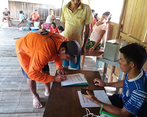 Kichwa forest monitors fill out a deforestation report in Sunullacta, Peru.