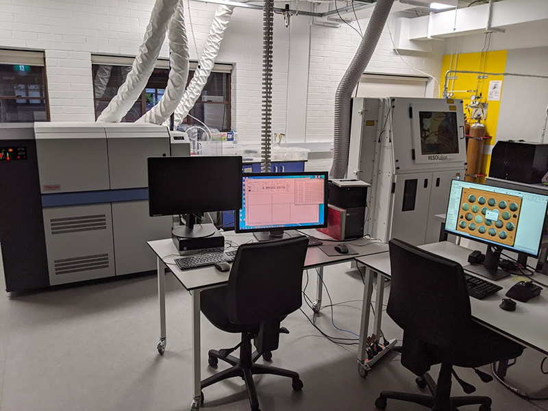 Scene in a laboratory with computers and monitors in front of a laser ablation mass spectrometer