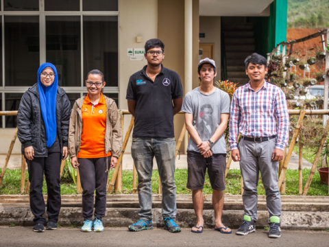 Researchers in front of a school in Sabah, Malaysia.