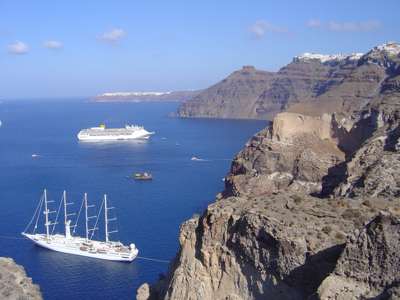 A photograph of the sheer cliffs of Santorini and the ocean below.