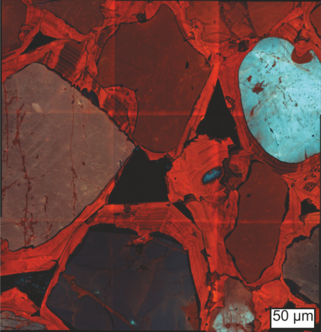 Cathodoluminescence imaging of a Stonehenge sarsen stone reveals the outlines of sand grains (pale blue, black) and multiple layers of quartz cement (red).